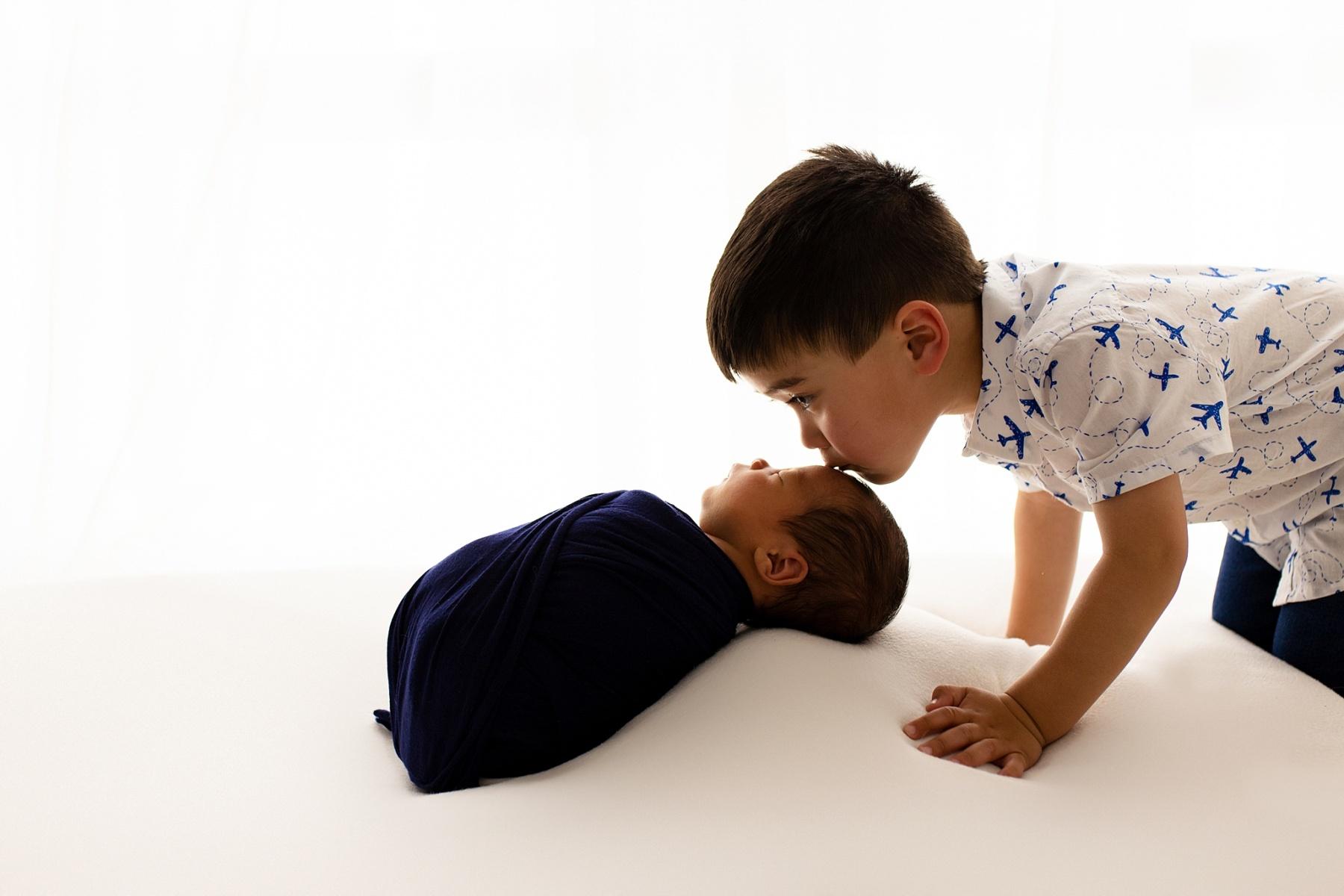 backlit newborn sibling photos Indianapolis Photo Studio