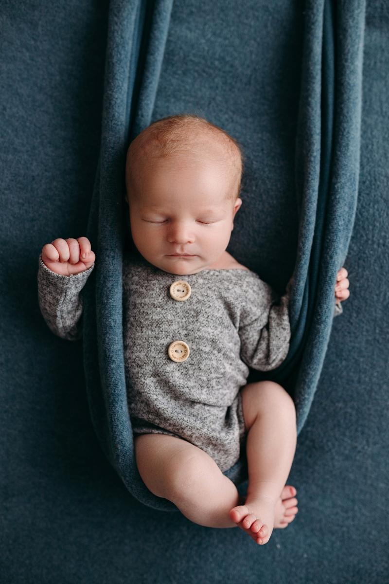 newborn sleeping swing newborn picture session