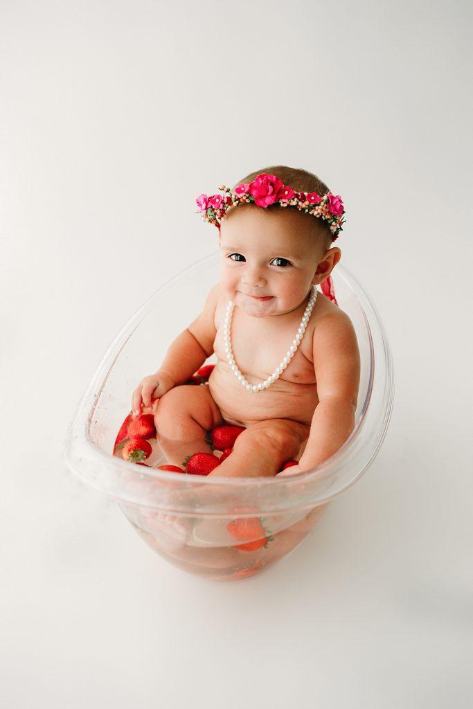 baby girl in fruit bath best photography studio indianapolis