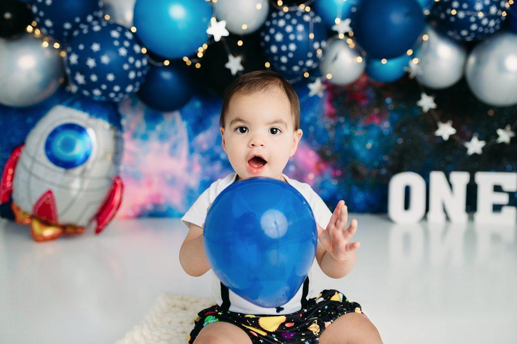 Boy holding balloon 12 month photos