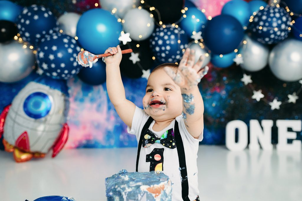 Boy covered in cake space themed photo shoot