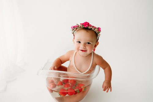 Baby in tub for baby milestone photo session Indianapolis