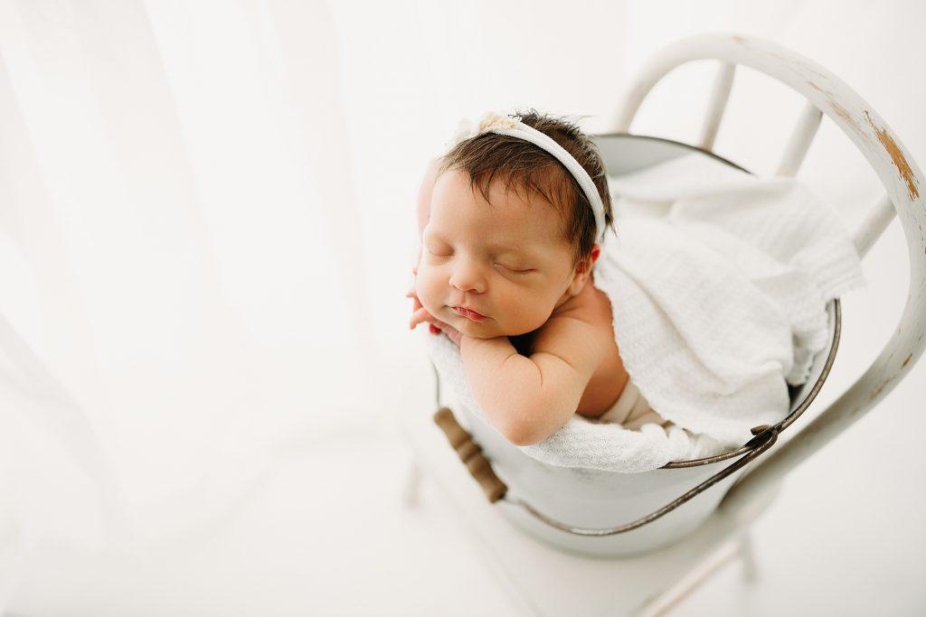 Best Newborn Photographer near me Baby in bucket by window