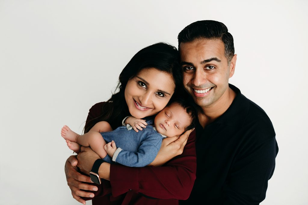 couple with newborn at photo session