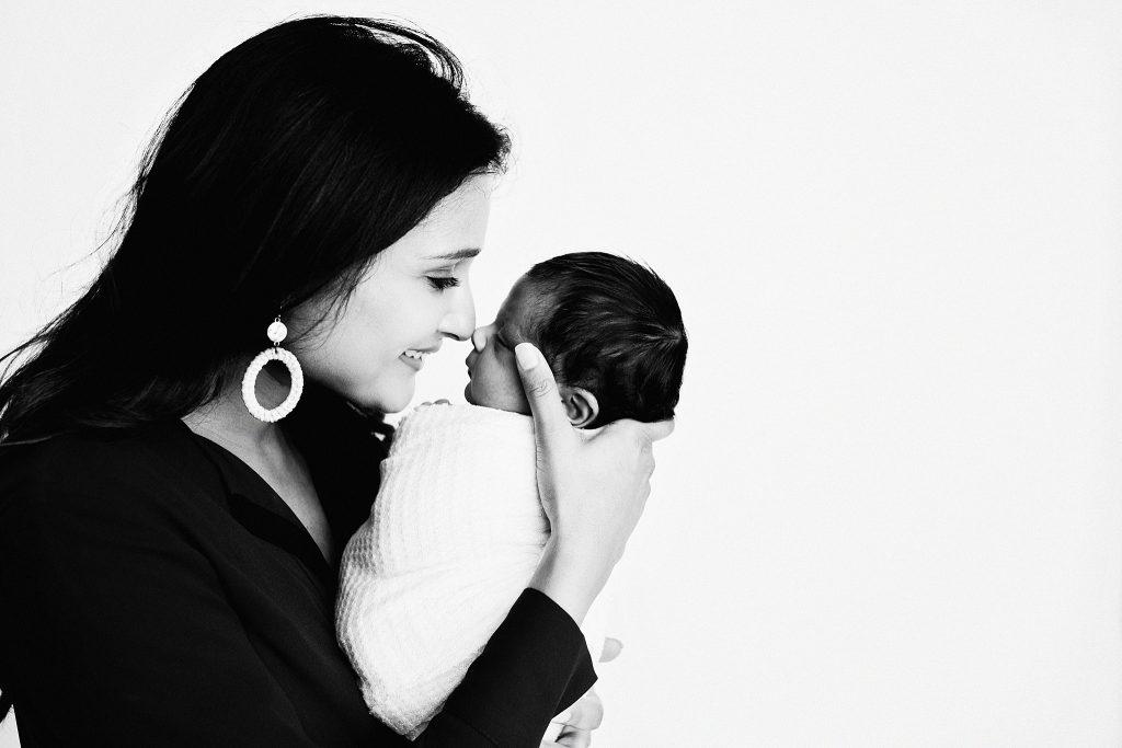 Indianapolis mom nuzzling swaddled baby