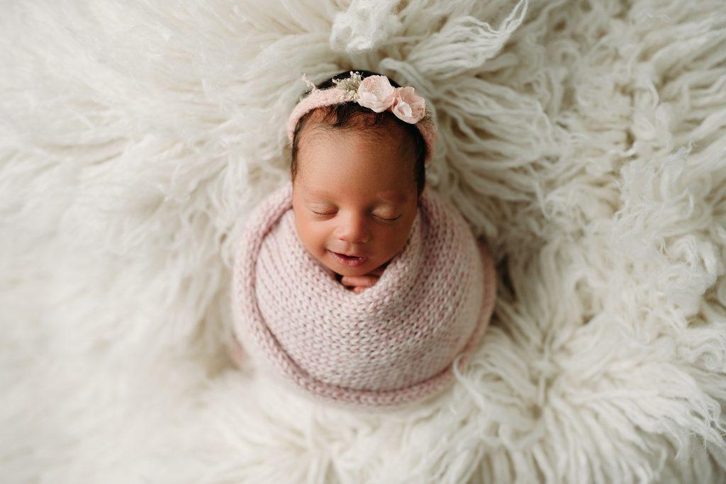 newborn girl potato wrap baby photo session