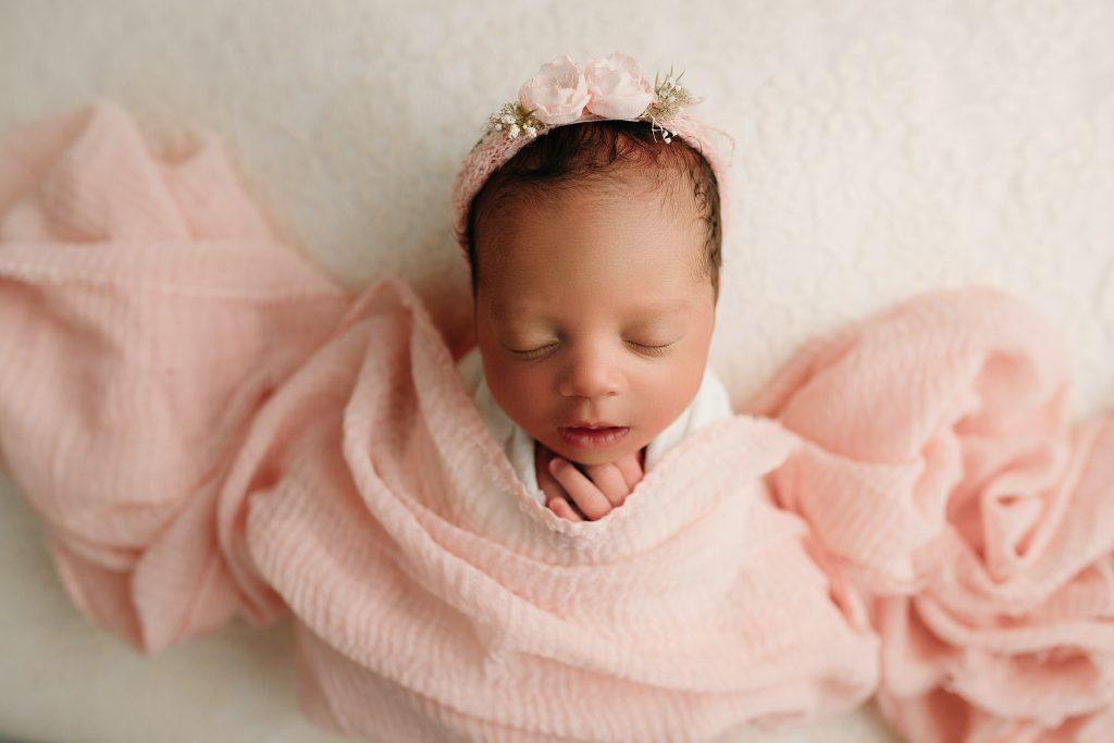 newborn girl in pink baby photos
