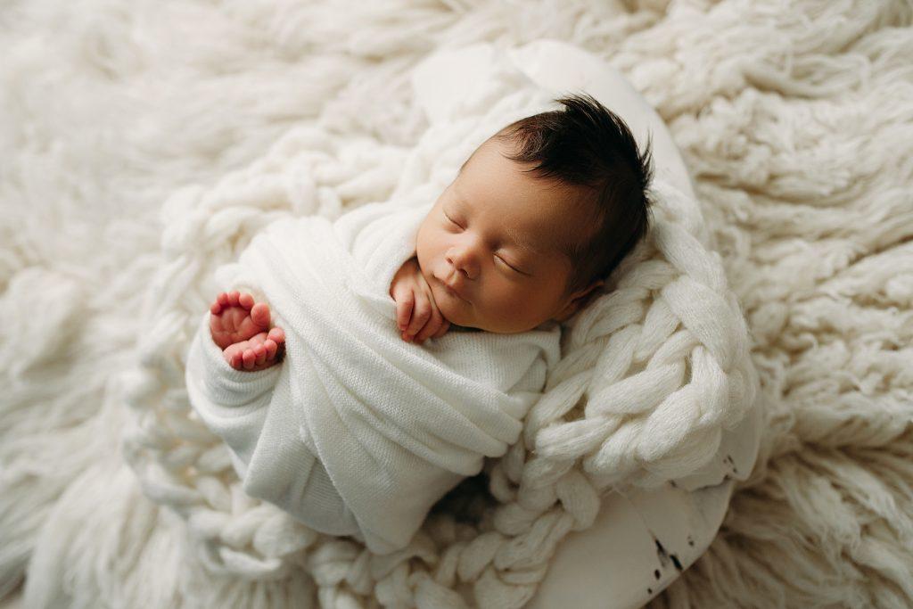 Boy swaddled for newborn photo