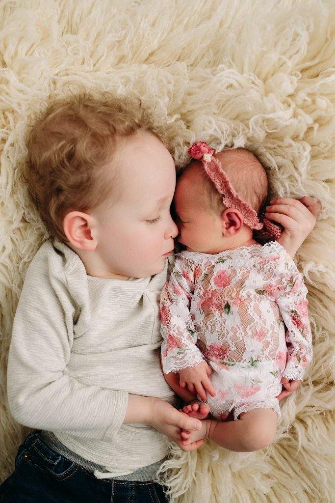 2 young kids sleeping at holly marie photography
