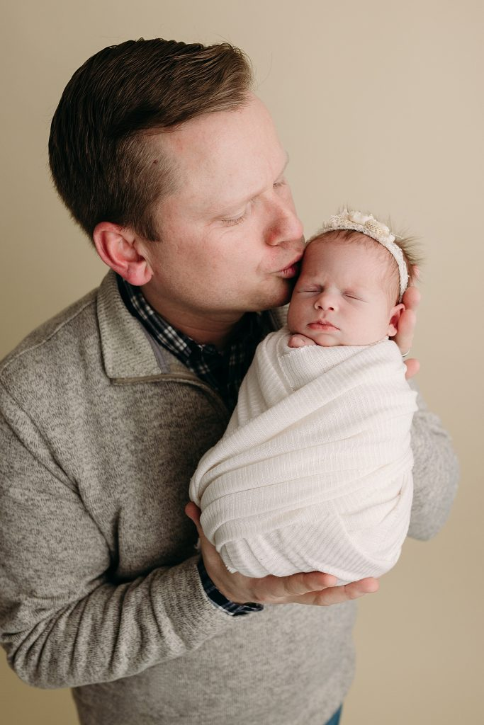Dad kissing baby girl Holly Marie Photography Studio