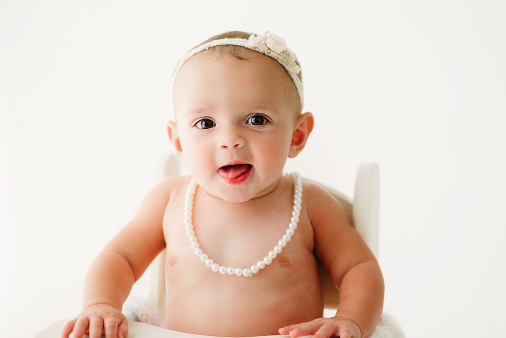 baby girl in high chair photo studio